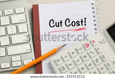 concept of cut cost, with calculator and desk background
