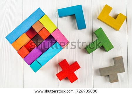 Concept of decision making process, creative, logical thinking. Geometric shapes in different colors, top view. Choose correct answer. Logical tasks. Conundrum, find the missing piece of the proposed.