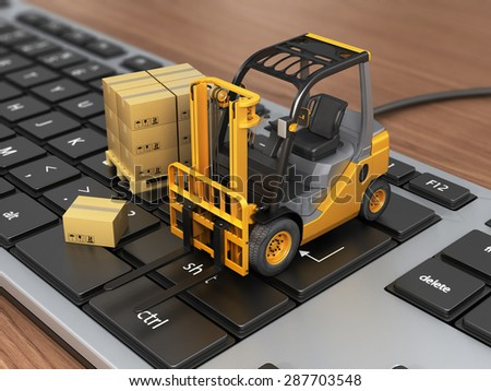 Concept of delivering, shipping or logistics. Forklift on keyboard. - stock photo
