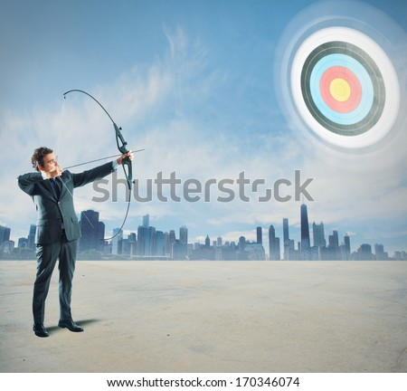 Concept of determinated businessman with bow and arrow - stock photo