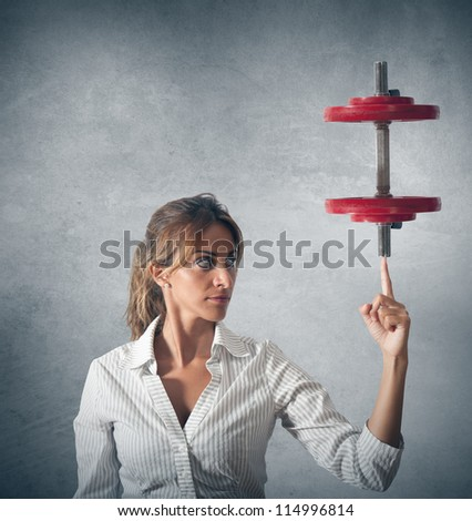 Concept of determinated businesswoman with wight of gym - stock photo