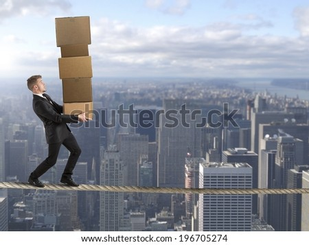 Concept of difficult career in business with businessman on the rope - stock photo