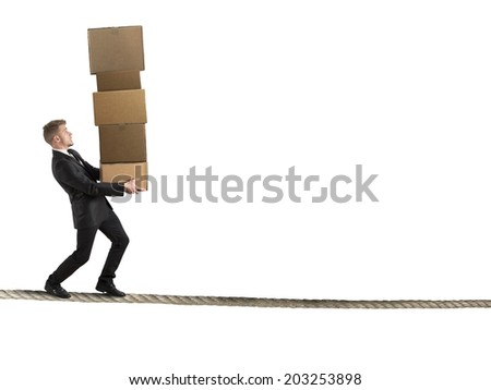 Concept of difficult career in business with businessman that holds a row of cartons - stock photo