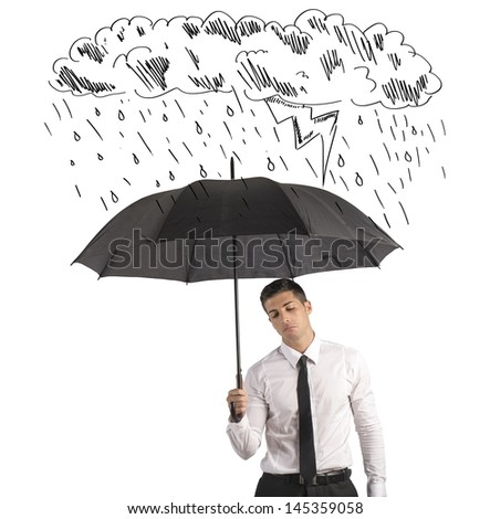 Concept of difficulty in business with umbrella - stock photo