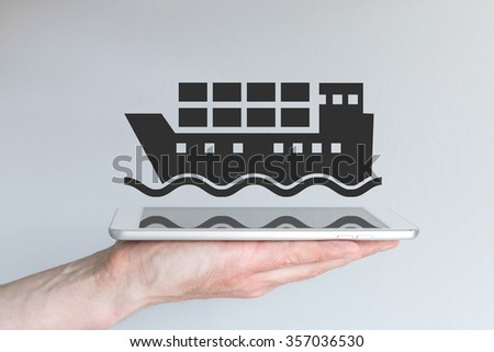 Concept of digital and mobile logistics and shipping business. Hand holding modern smart phone or tablet. - stock photo