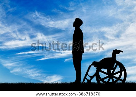 Concept of disability and disease. Silhouette of disabled and wheelchair daytime
