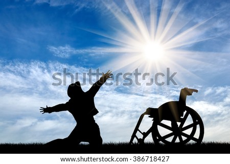Concept of disability and positive. Silhouette happy invalid against the sky