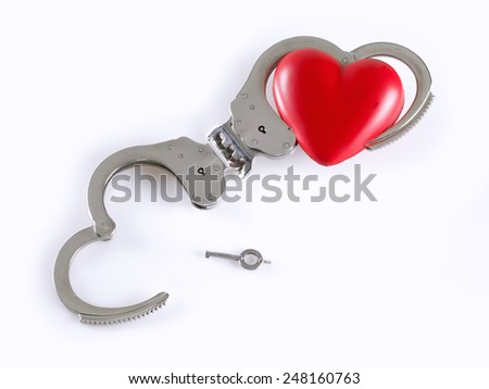 Concept of divorce adapted to handcuffs. One of them is open and free, on white background