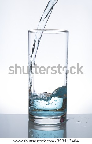 Concept of drinking. glass of water - stock photo