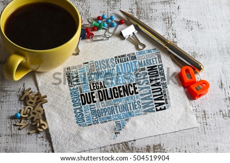 concept of DUE DILIGENCE word cloud on a napkin with pen and cup of coffee