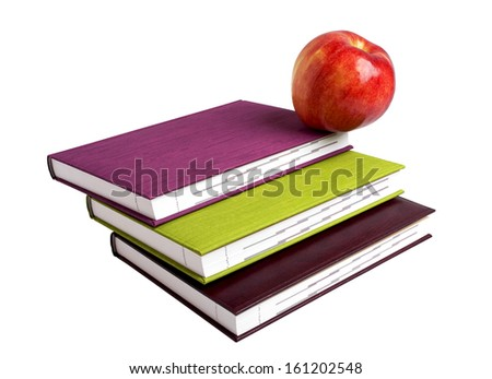 Concept of education. A red apple on top of a stack of the books.