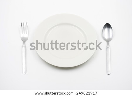 Concept of Empty plate with spoon and fork on a white background
