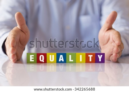 Concept of EQUALITY Word on Colorful Wooden Cubes - stock photo