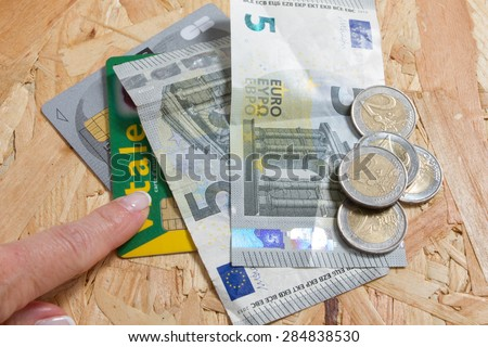 Concept of expensive healthcare with coins,notes and french health card - stock photo