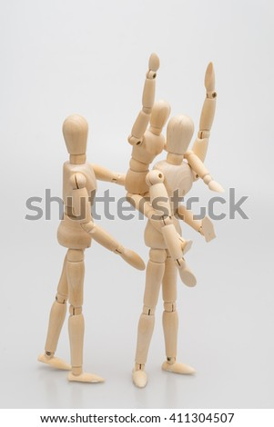 concept of family by man Wood Figure ,women Wood Figure and child wood figure ./white background