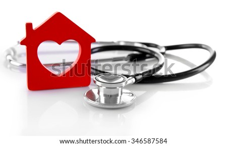 Concept of family medicine - red plastic house and stethoscope isolated on white background - stock photo