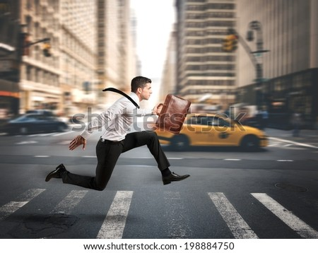 Concept of fast business with running businessman - stock photo