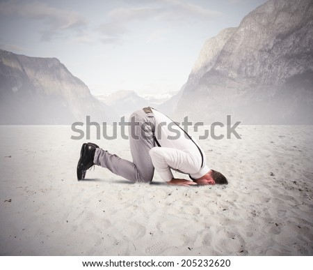 Concept of fear of the crisis with businessman like an ostrich - stock photo