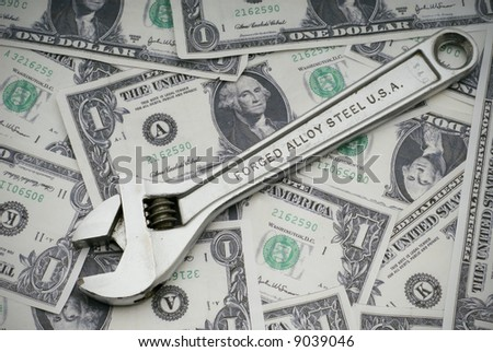 Concept of fixing the US economy with a wrench on US currency
