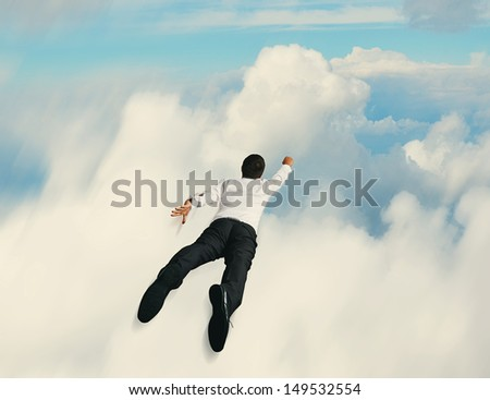 concept of flying super hero businessman - stock photo
