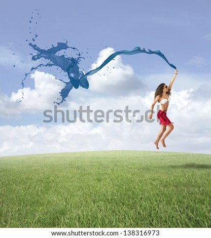 Concept of freedom with jumping girl in a field