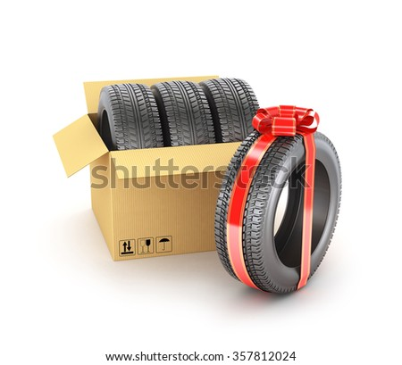Concept of gift. The car tires in the cardboard box and one tire in gift ribbon. - stock photo