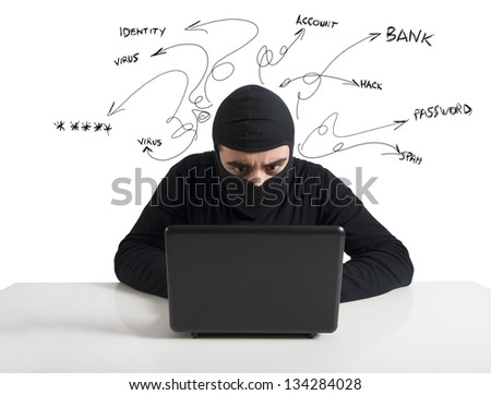 Concept of hacker at work with laptop - stock photo