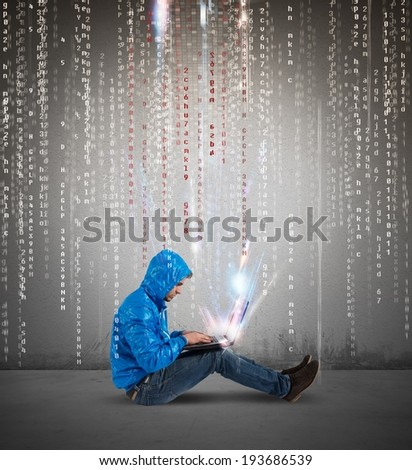 Concept of hackering with a boy with laptop and binary code