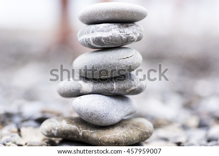 concept of harmony and balance with rocks on the beach. in the background a beach