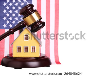 Concept of house sale with gavel and American Flag isolated. Foreclosure - stock photo