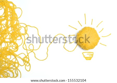 Concept of idea and innovation with wool ball - stock photo