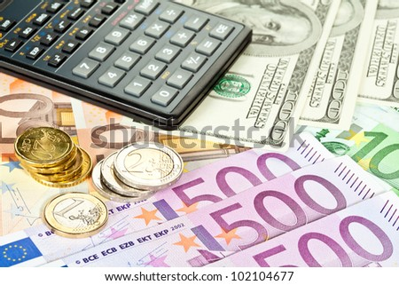 Concept of increase of capital: euro and dollar banknotes, coins and calculator