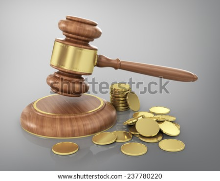 Concept of law. Wooden gavel with gold coins. - stock photo