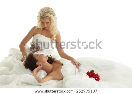 Concept of lesbian wedding. Two alluring brides