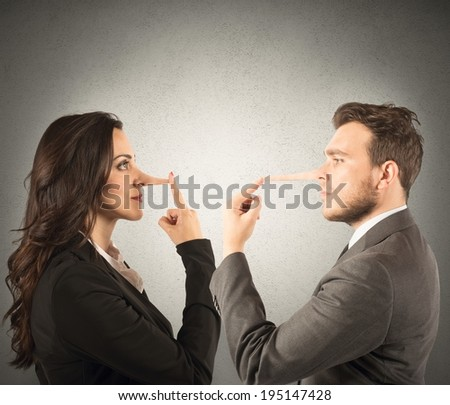 Concept of lie with couple with long nose - stock photo
