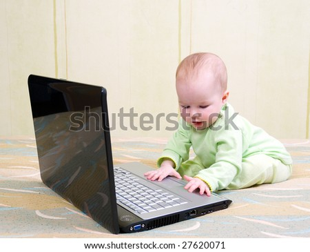 Concept of little businessman. Little child and laptop