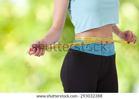 concept of losing weight with sport - stock photo