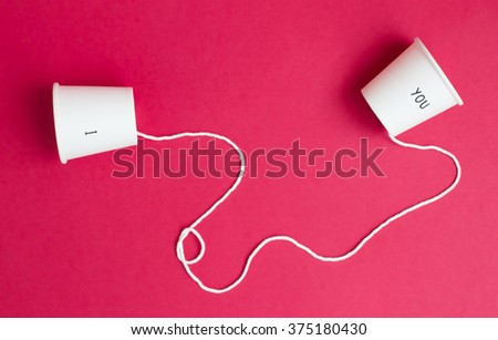 Concept of love which have couple coffee cup and connect them with white rope on red background.