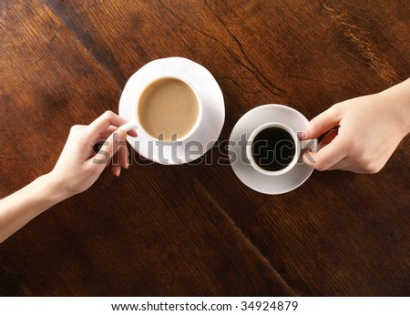Concept of male and female hands, love and coffee - stock photo