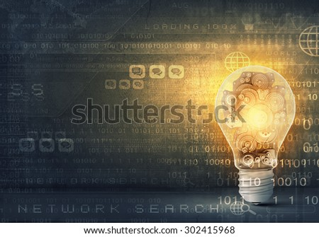 Concept of mechanism light bulb with gears inside - stock photo