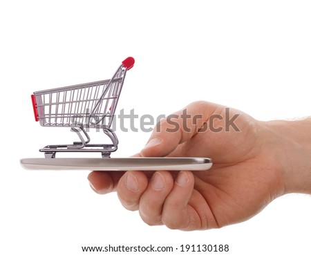 concept of mobile shopping with a shopping cart in a mobile phone isolated on a white background - stock photo