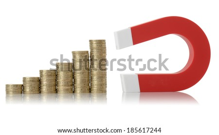 concept of money growth increasing piles of coins drawn by a magnet - stock photo