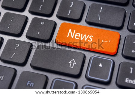 concept of online or internet news, with message on enter key of keyboard. - stock photo