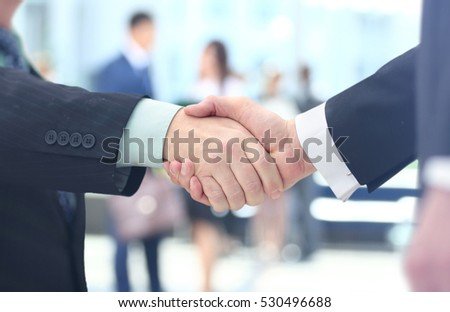 Concept of partnership - handshake  business partners