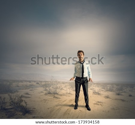 Concept of poor businessman for the crisis problem - stock photo