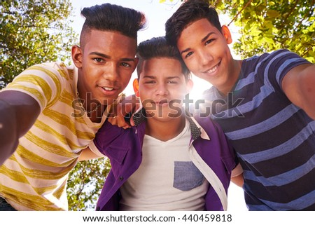 Concept of racism and integration. Portrait of happy boys smiling looking at camera.  - stock photo