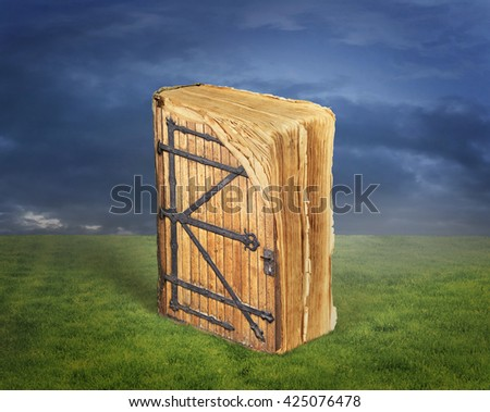 Concept of reading. Ancient book with a door to the magical world of reading on grass. Concept of knowledge. - stock photo