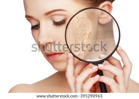 concept of rejuvenation and skincare. face of a beautiful girl with a problem skin and magnifier