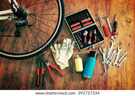 Concept of repairing or maintenance bike with tools and bottles - stock photo