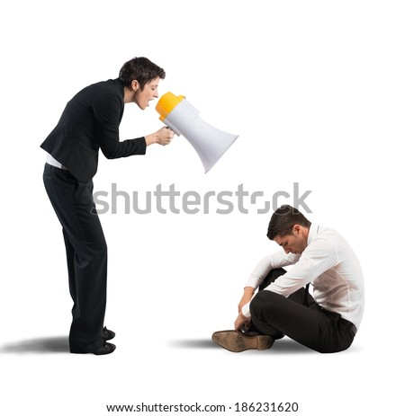 Concept of reproach with businessman shouting through a megaphone - stock photo